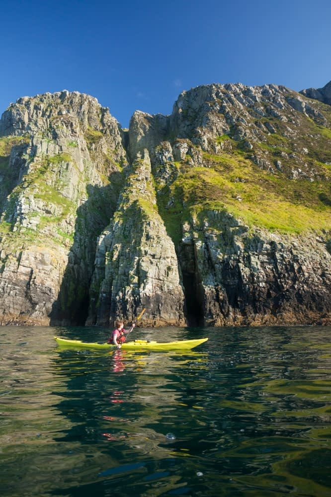 Sea kayaking benath Horn Head, County Donegal, Ireland.