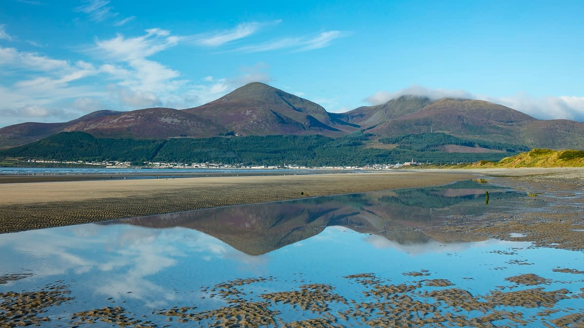 Mourne Mountains reflected in Newcastle Beach, Murlough Nature Reserve, County Down, Northern Ireland.