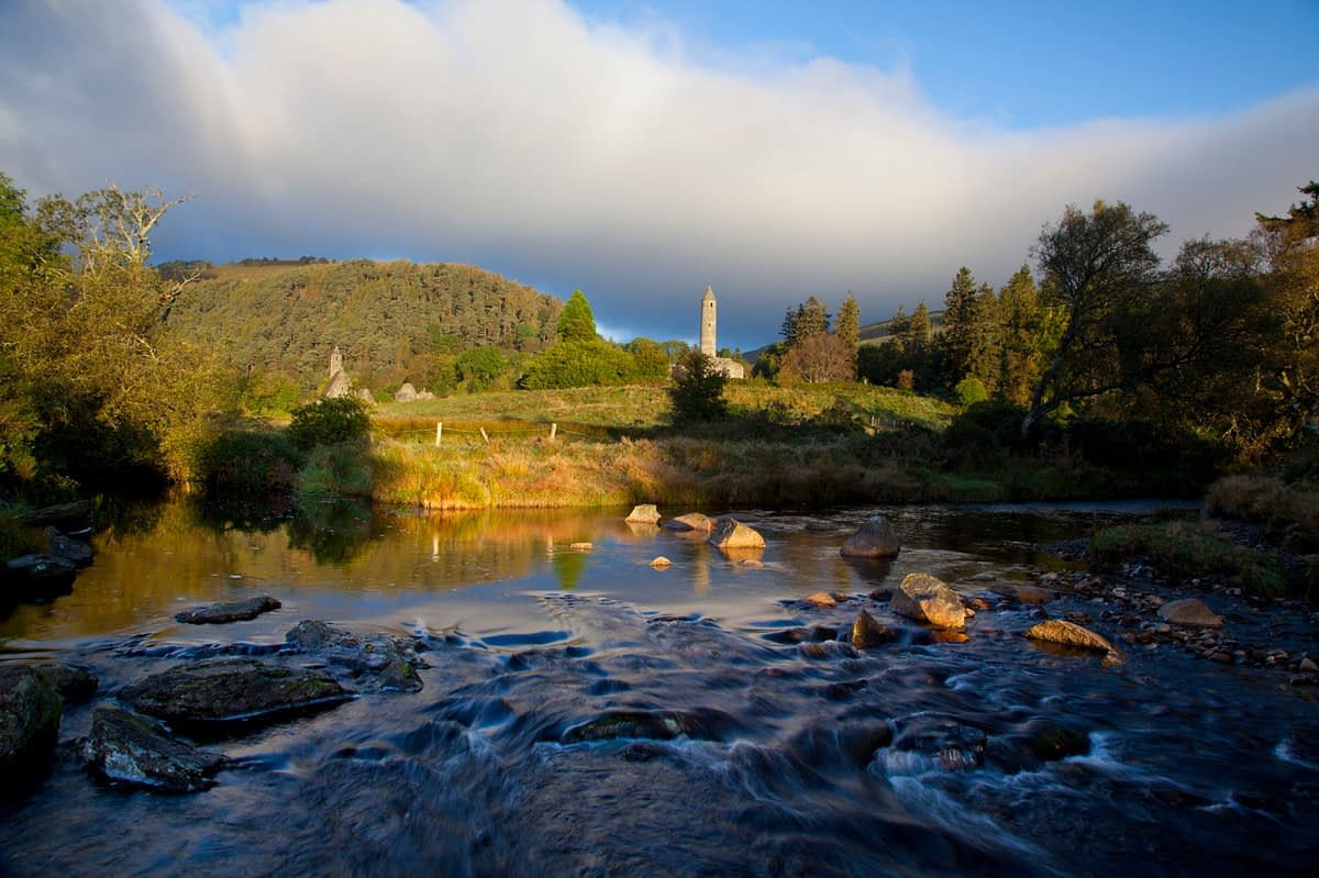 Glendalough round tower and stream, Wicklow Mountains National Park, Co Wicklow, Ireland.