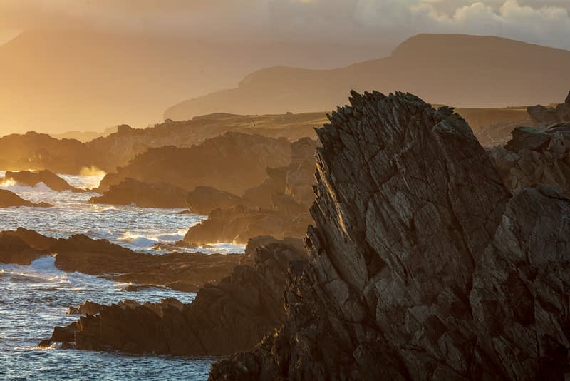 Rocky evening coastline along the Atlantic Drive, Achill Island, County Mayo, Ireland.