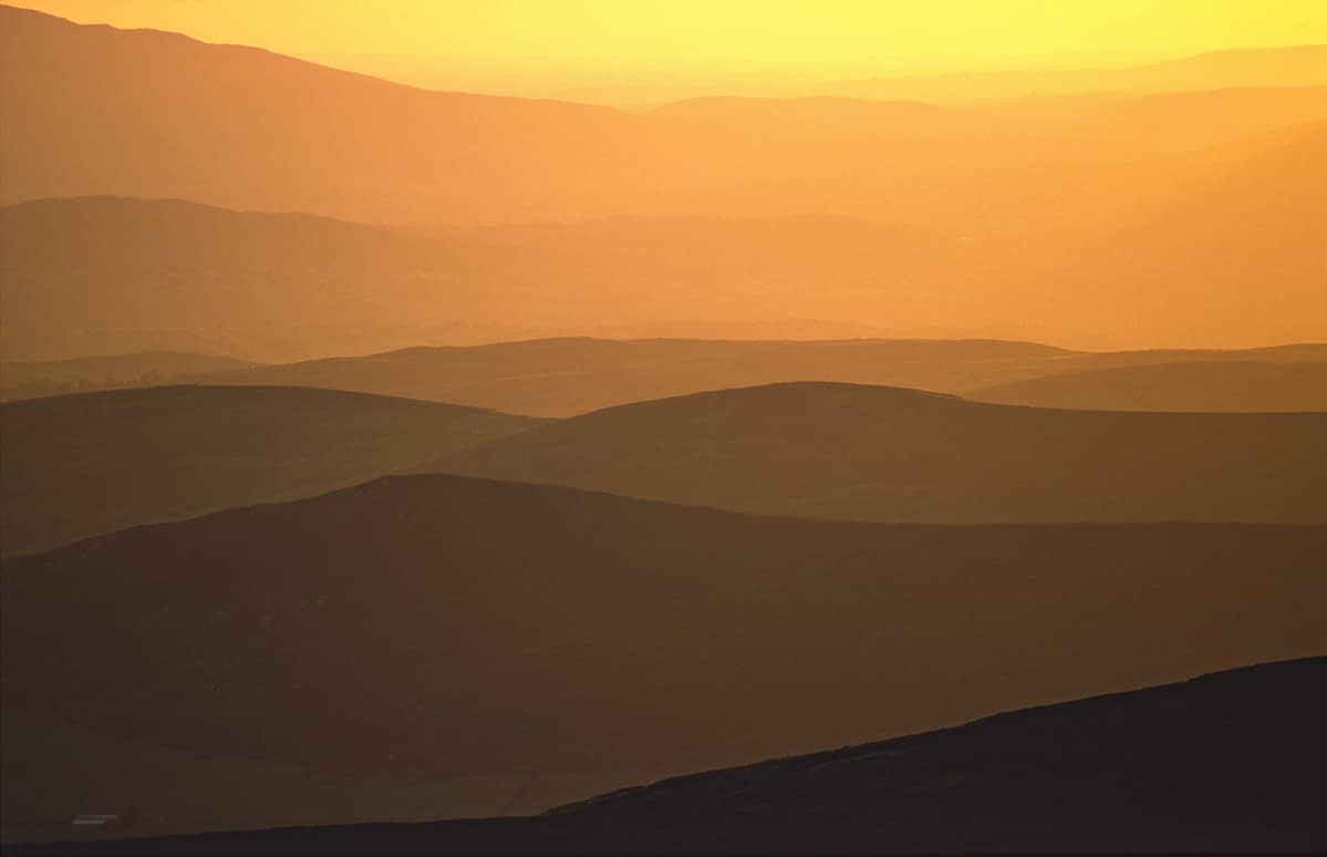 Sunset over the ridges of the Mourne Mountains, Co Down, Northern Ireland.