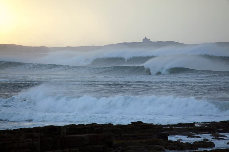Surfers in Donegal Bay, County Donegal, Ireland.
