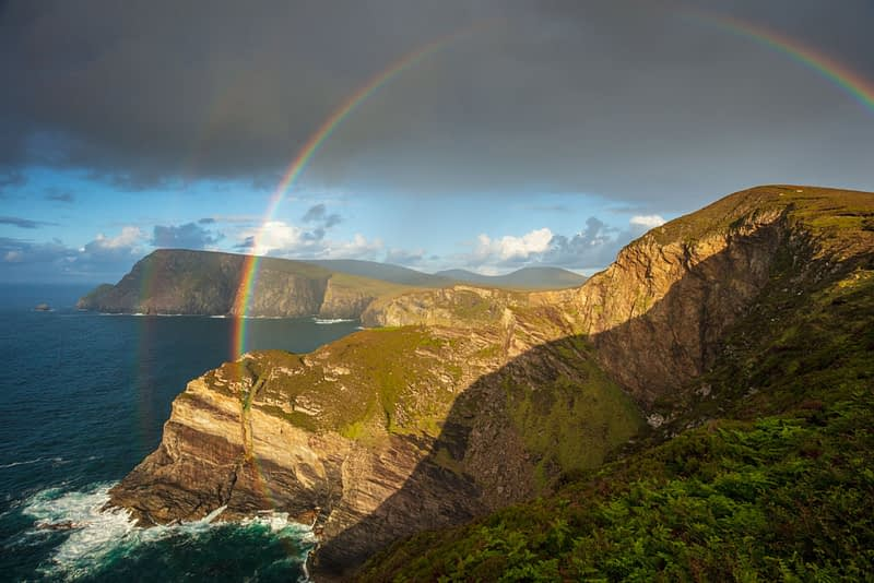 Rainbow over the north Mayo sea cliffs, County Mayo, Ireland.