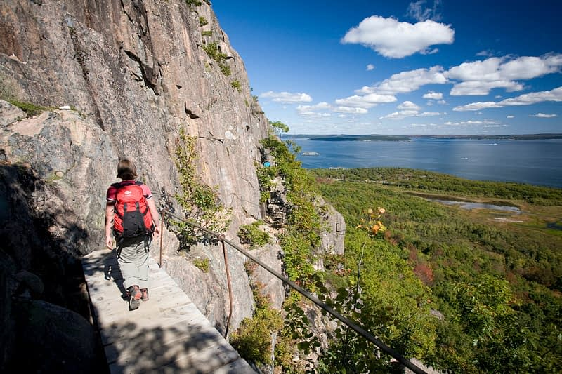 Hiker on the Precipice Trail, Acadia National Park, Maine, New England, USA.