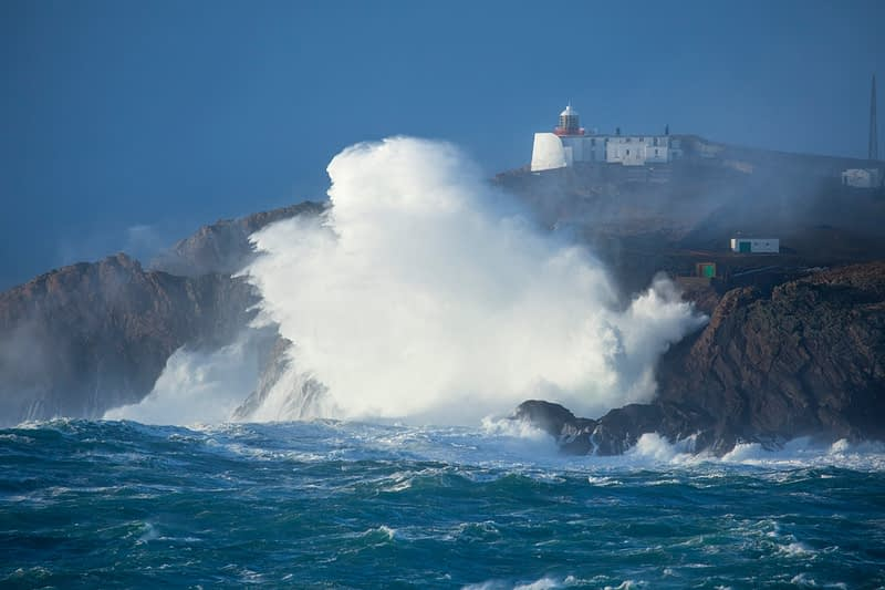 Storm waves crash 75m high above Eagle Island Lighthouse, Belmullet, County Mayo, Ireland.