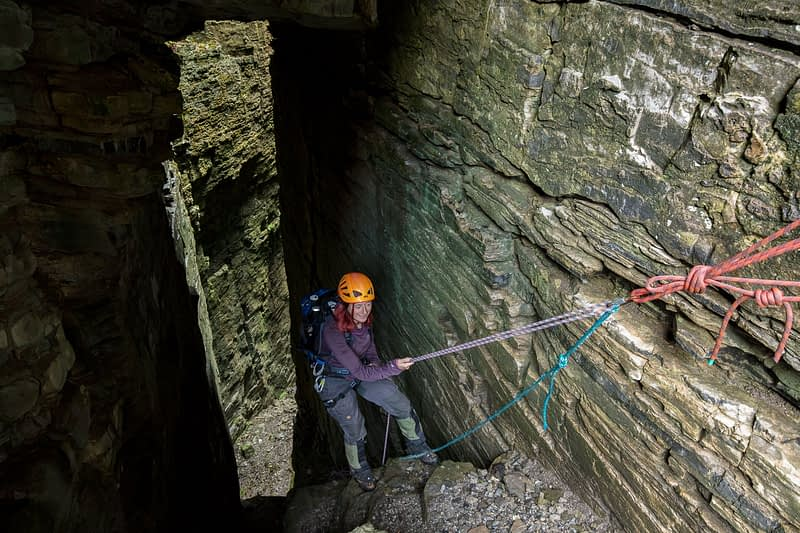 Abseiling into Annach Re Mhor chasm, Kings Mountain, County Sligo, Ireland.