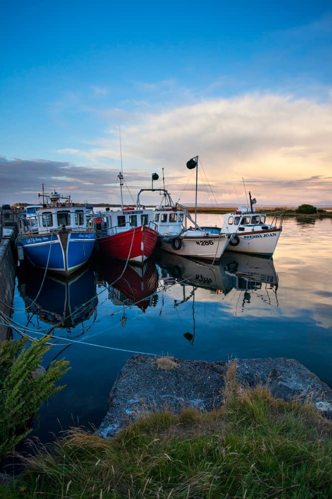 Evening fishing boats at Killala pier, County Mayo, Ireland.