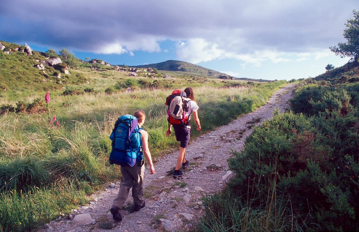 Walkers on the Old Kenmare Road, Kerry Way, Co Kerry, Ireland.
