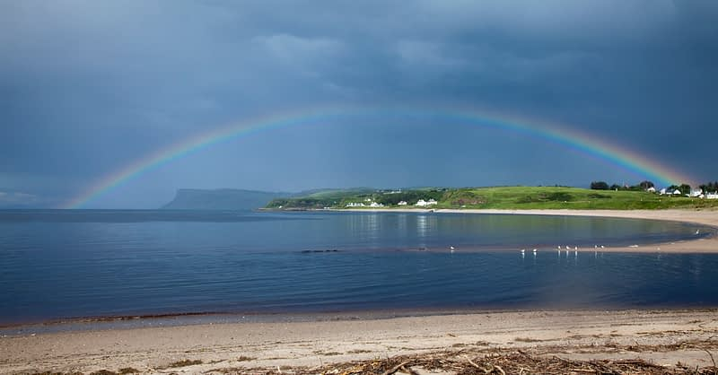 Rainbow across Ballycastle Beach, County Antrim, Northern Ireland.
