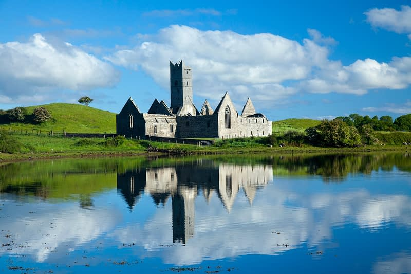 Reflection of Rosserk Abbey in the River Moy, County Mayo, Ireland.