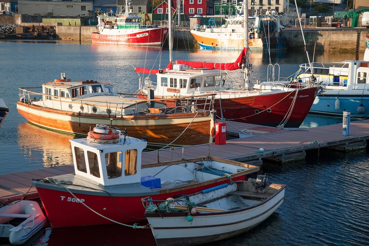 Fishing boats moored in Dingle Harbour, Country Kerry, Ireland.