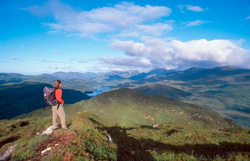 Walker looking over MacGillycuddy's Reeks from Torc Mountain, Co Kerry, Ireland.