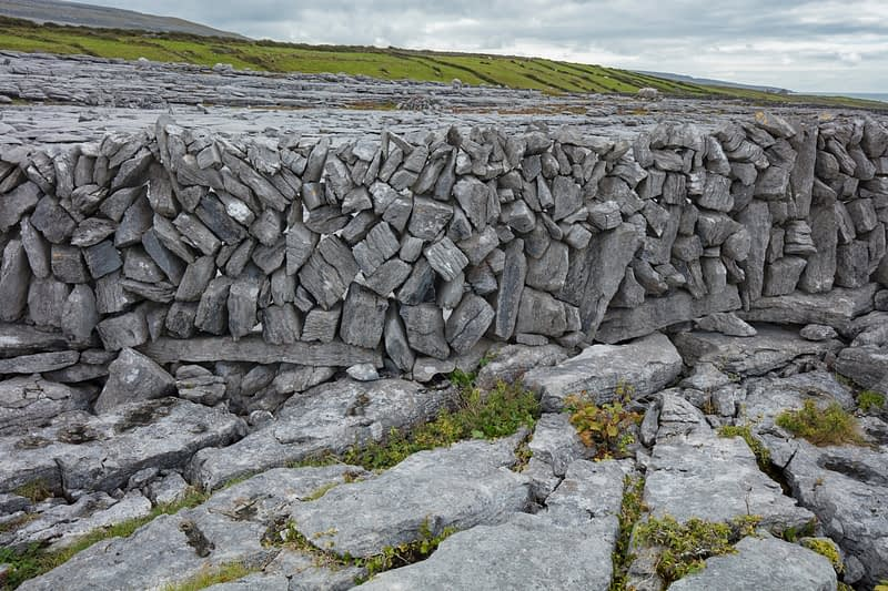 Stone wall and limestone pavement, The Burren, County Clare, Ireland.