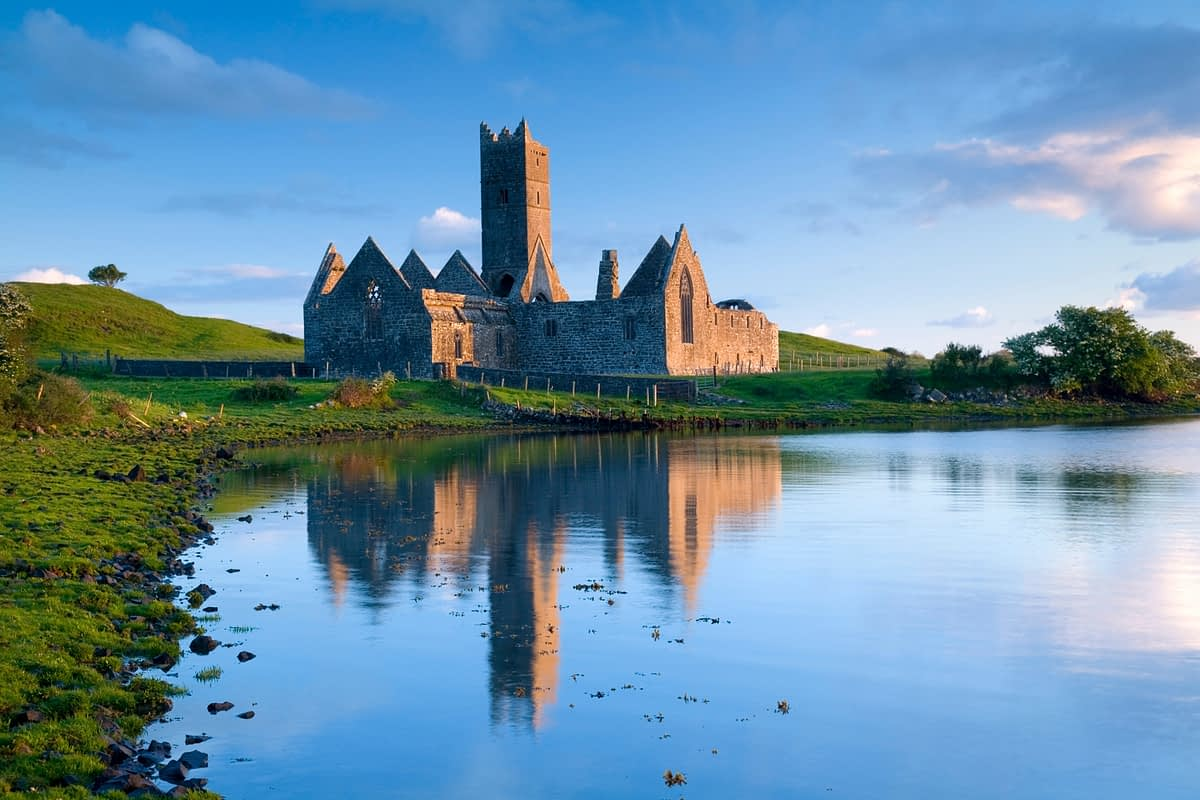 Dawn reflections of Rosserk Abbey, Co Mayo, Ireland.