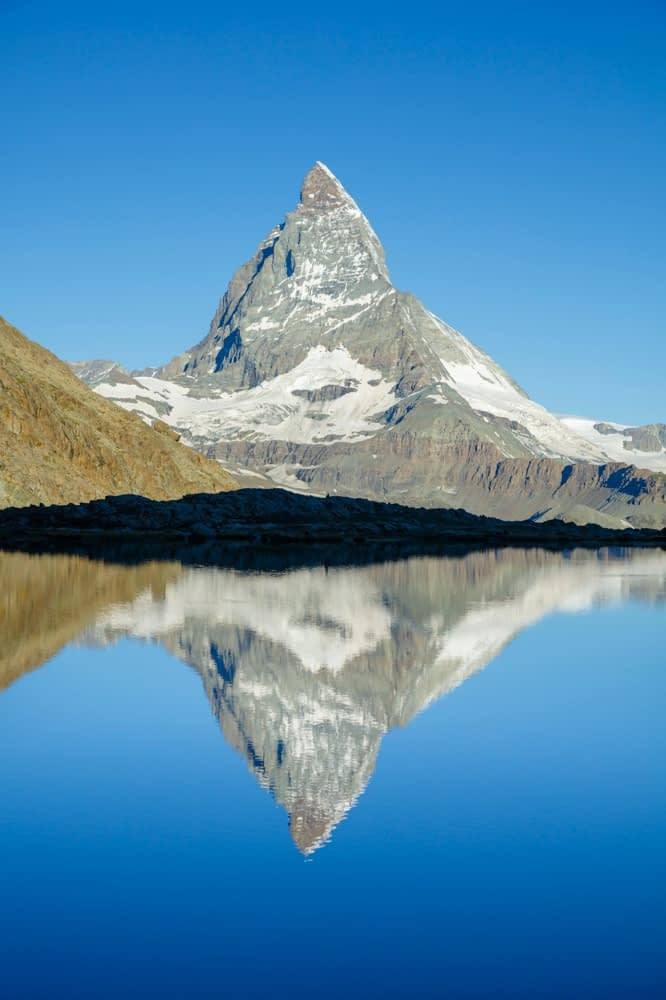 Matterhorn reflected in the Riffelsee, Zermatt, Valais, Switzerland.
