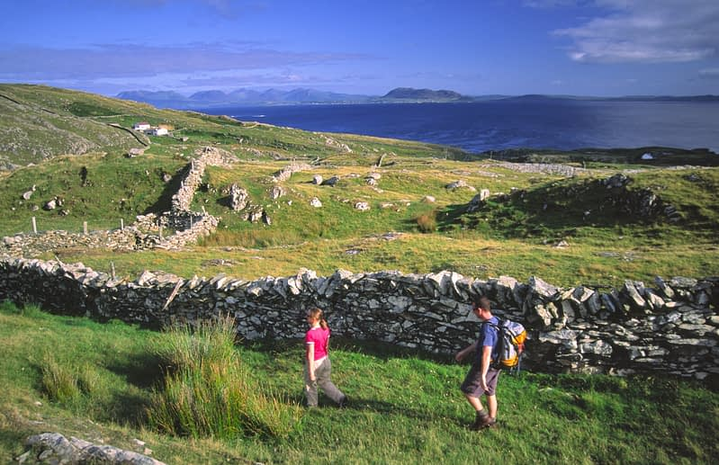 Walkers exploring Inishturk Island, Co Mayo, Ireland.