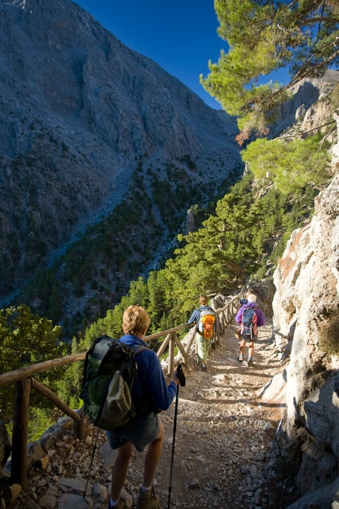 Hikers descending into the Samaria Gorge, Samaria National Park, Crete, Greece.