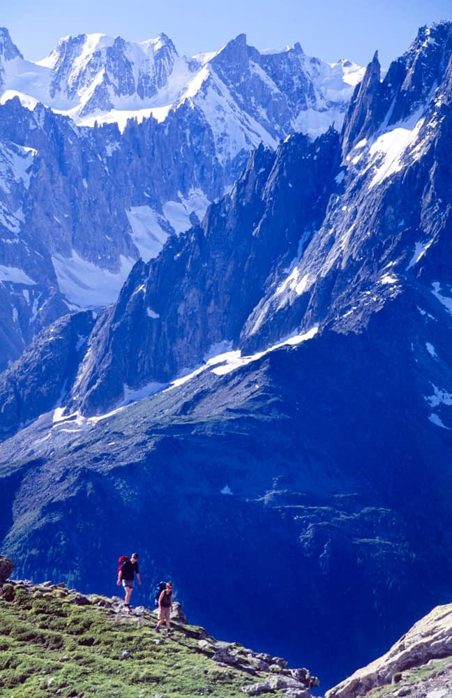 Walkers on the Balcon Sud beneath the Chamonix Aiguilles, Chamonix Valley, French Alps, France.