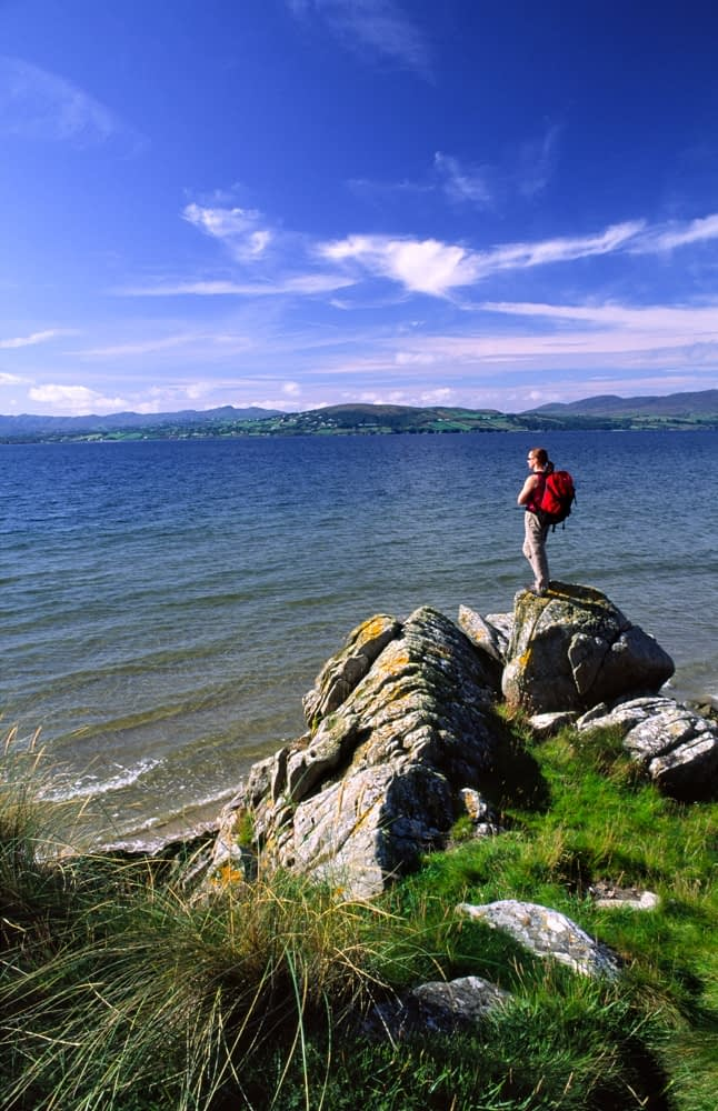 Walker on Buncrana coastal path, Inishowen, Co Donegal, Ireland.