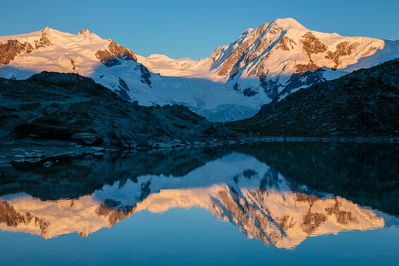 Evening reflection of Lyskamm in the Riffelsee, Zermatt, Valais, Switzerland.
