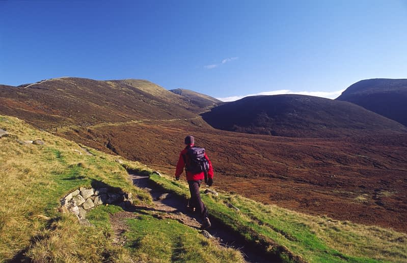Walker on the Brandy Pad, Mourne Mountains, Co Down, Northern Ireland.