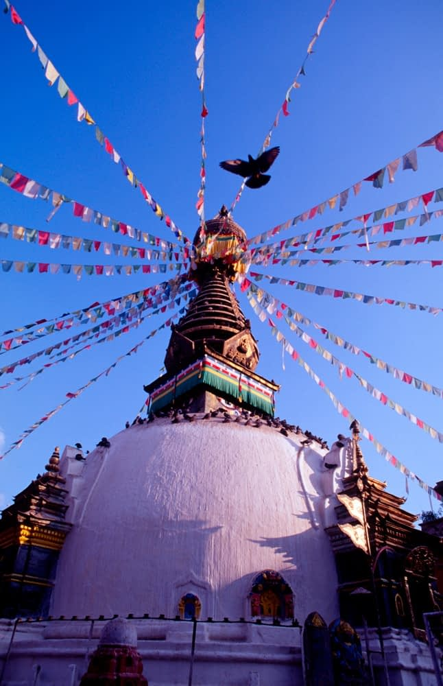 Prayer flags flying from Swayambhunath Stupa, Kathmandu, Nepal.