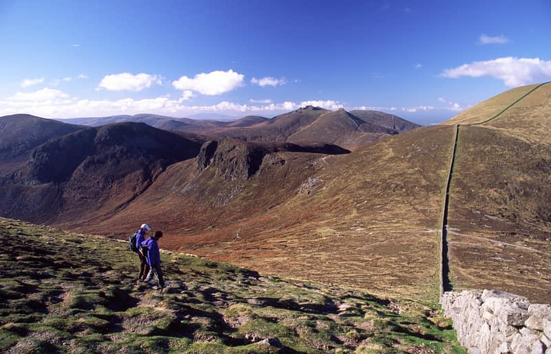 Walkers descending from Slieve Donard, Mourne Mountains, Co Down, Northern Ireland.