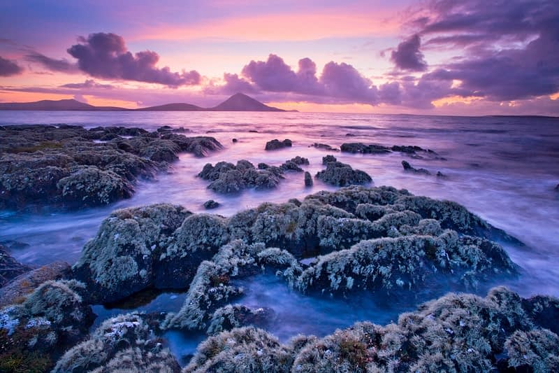 Sunset over lichen-covered coastline, Ballycroy, Co Mayo, Ireland.