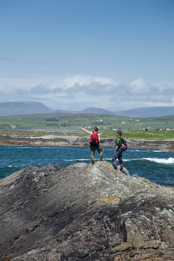 Walkers looking over Coulagh Bay, Beara Way, Co Cork, Ireland.