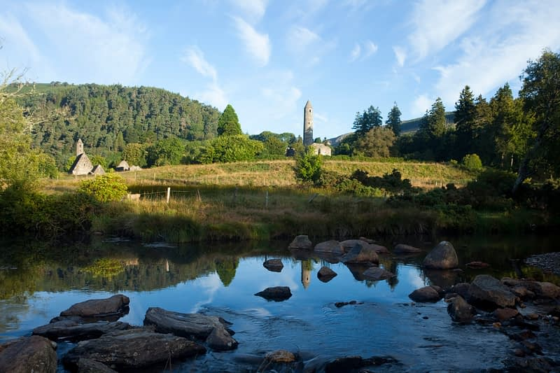 Reflection of Glendalough round tower, Wicklow Mountains National Park, Co Wicklow, Ireland.