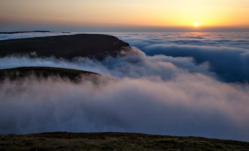 Sunset clouds rolling over Glinsk mountain, North Mayo seacliffs, County Mayo, Ireland.