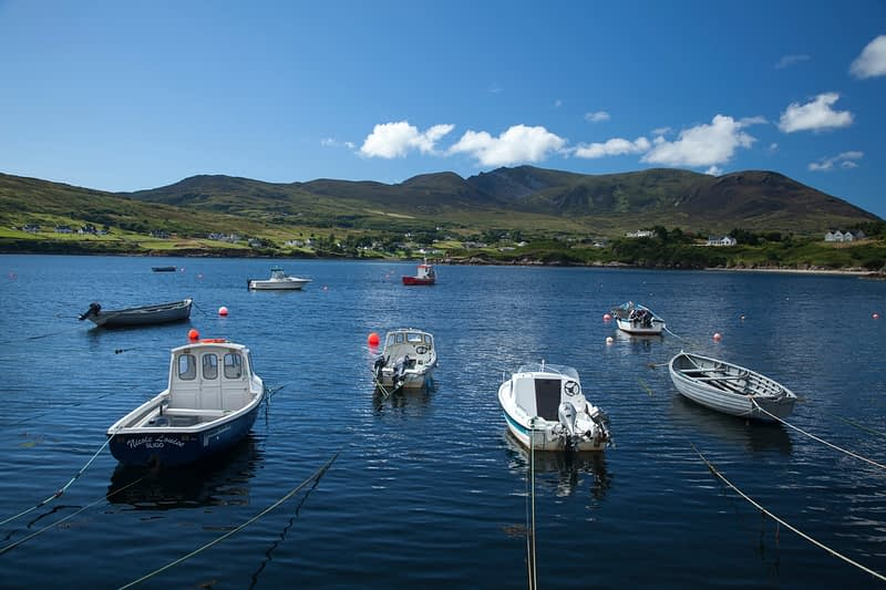 Boats moored at Doonan Pier, beneath Slieve League, County Donegal, Ireland.