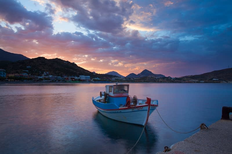 Sunrise over Plakias Harbour, Crete, Greece.