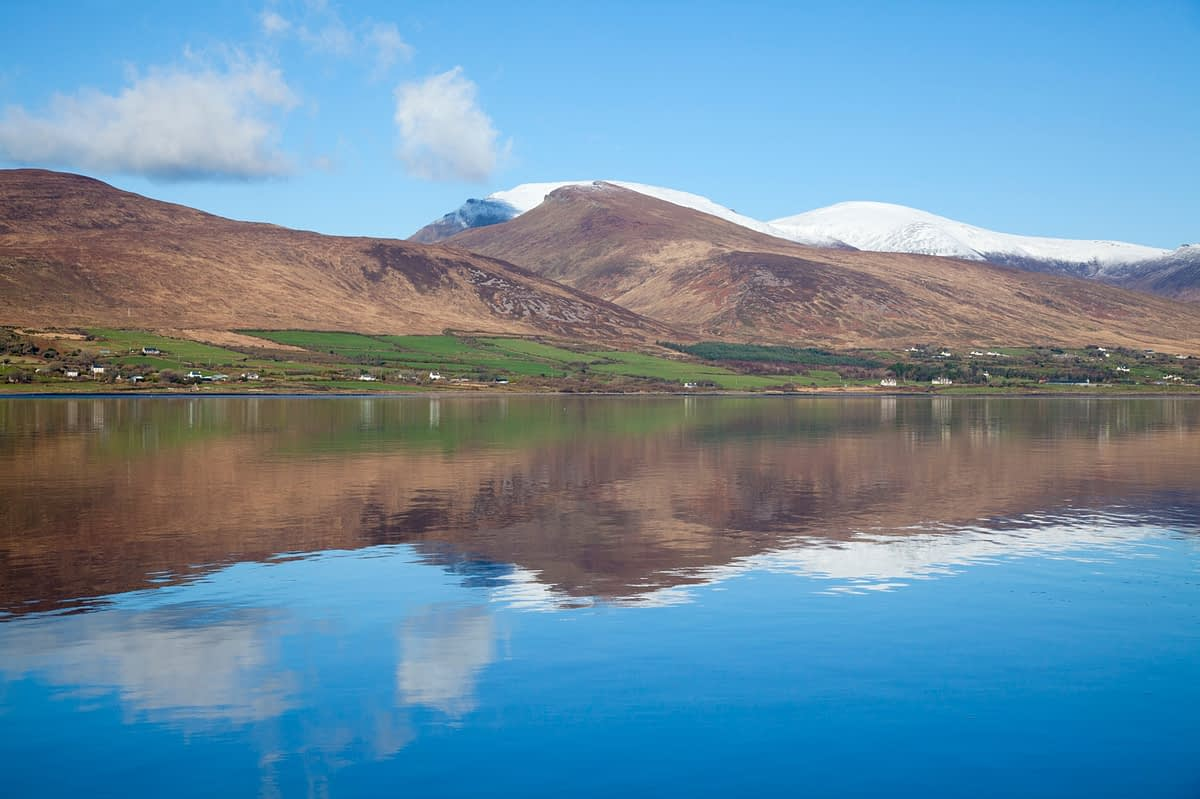 The Slieve Mish Mountains reflected in Dingle Bay, Cromane, Dingle Peninsula, County Kerry, Ireland.