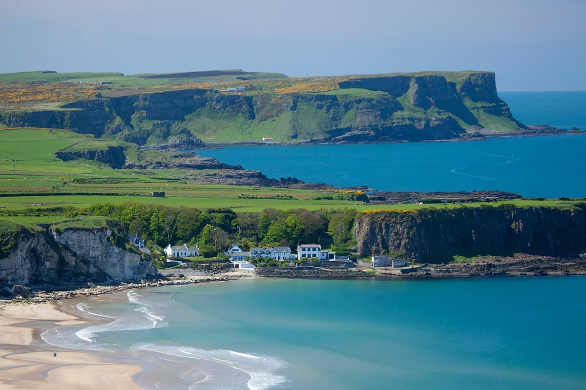 View across White Park Bay and Portbraddan, Causeway Coast, County Antrim, Northern Ireland.