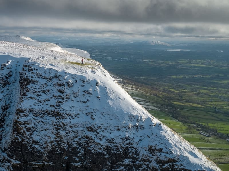 Aerial view of winter walker on Benbulbin Mountain, County Sligo, Ireland.