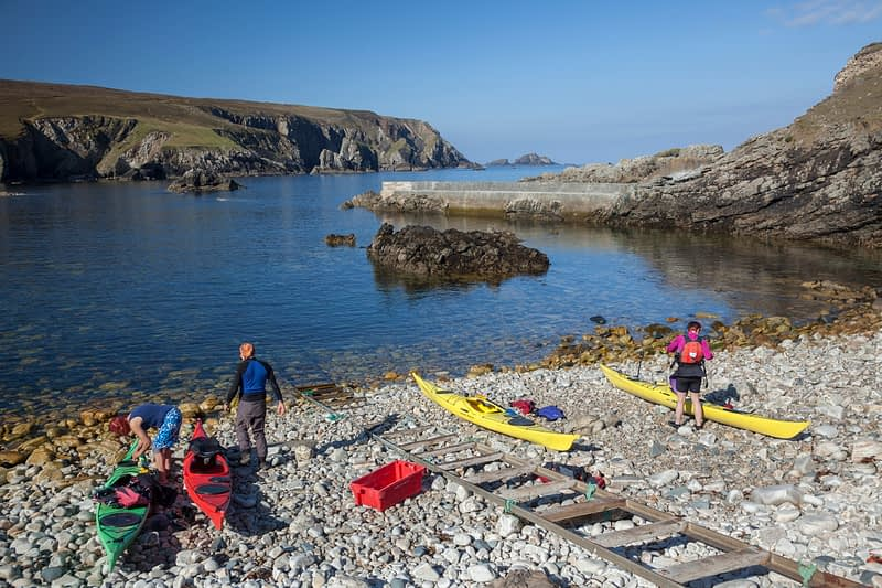 Sea kayakers preparing for departure, Port, Glencolmcille, County Donegal, Ireland.