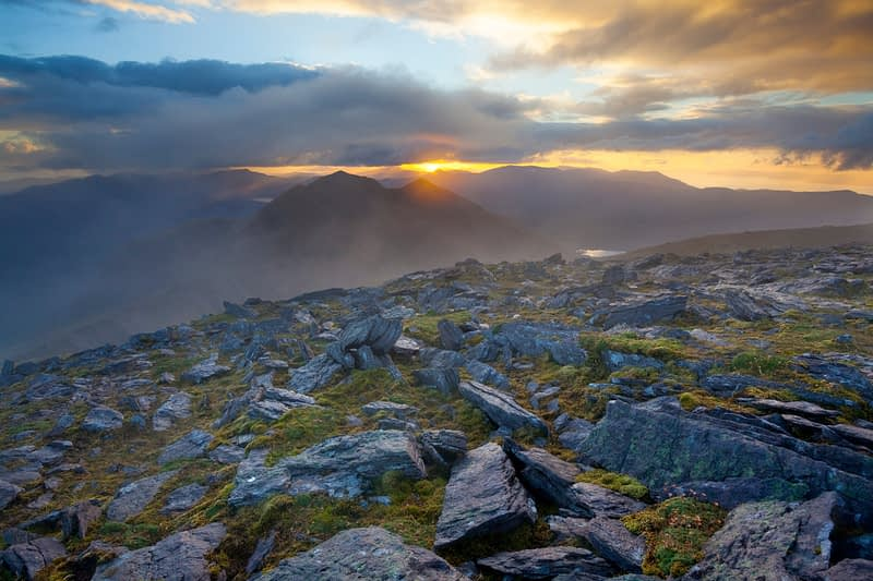 Sunset over Caher, Ireland's third highest mountain, from Carrauntoohil, MacGillycuddy's Reeks, County Kerry, Ireland.