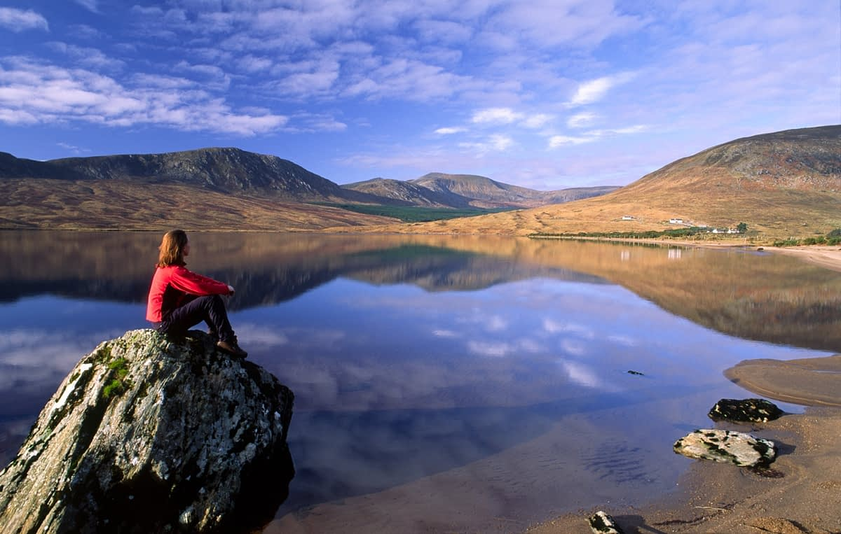 Person looking over Lough Feeagh, Nephin Beg Mountains, Co Mayo, Ireland.
