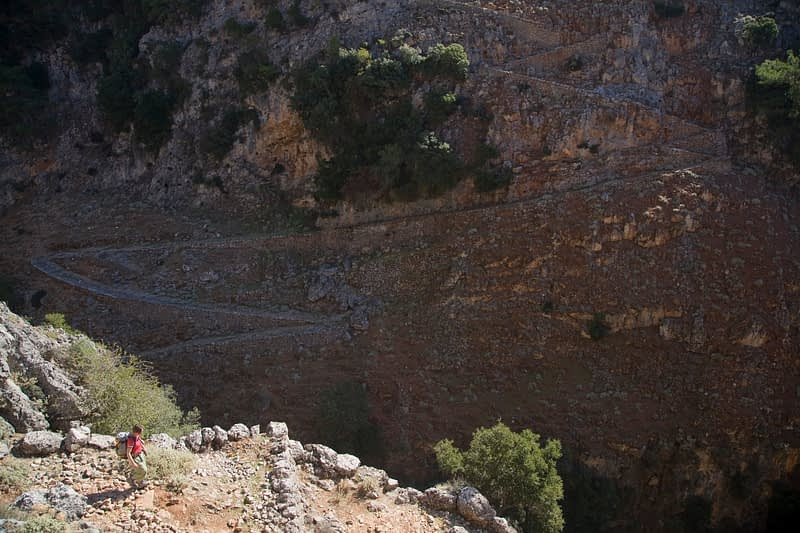 Hiker descending into the Aradena Gorge, White Mountains, Crete, Greece.