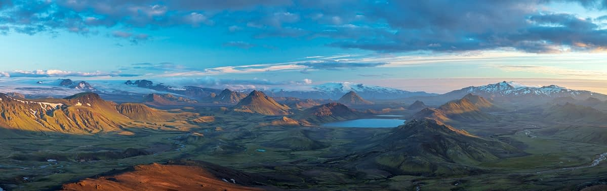 Evening view over the mountains and lake at Alftavatn, from Jokultungur on the Laugavegur hiking trail. Central Highlands, Sudhurland, Iceland.