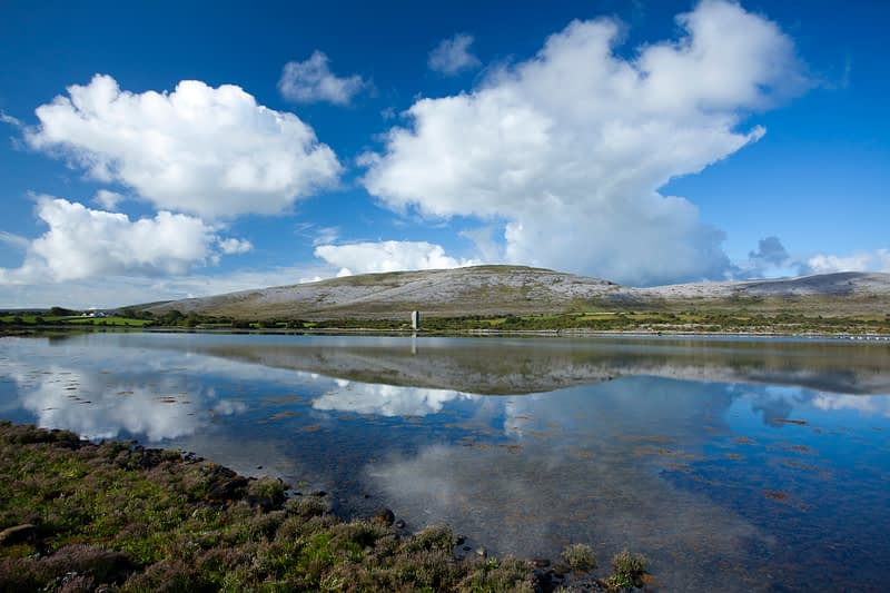 The landscape of The Burren reflected in Ballyvaghan Bay, Co Clare, Ireland.