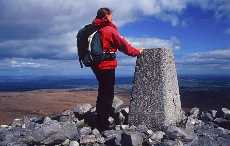 Walker at the summit of Cuilcagh Mountain, Co Fermanagh, Northern Ireland.