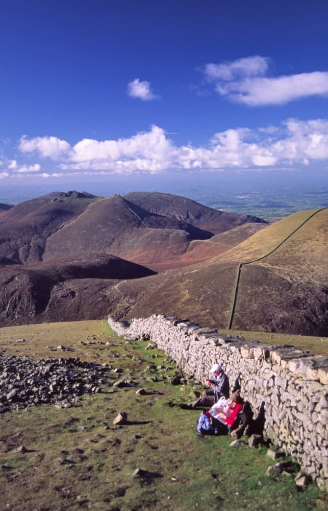 Walkers resting at the top of Slieve Donard, Mourne Mountains, Co Down, Northern Ireland.