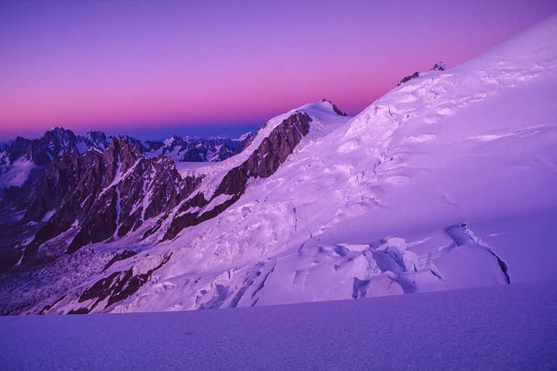 Twilight across Tacconaz Neve from the slopes of Mont Blanc, Chamonix Valley, French Alps, France.