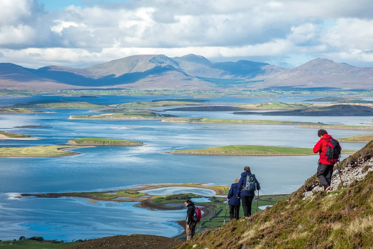 Walkers on the slopes of Croagh Patrick, above Clew Bay, County Mayo, Ireland.