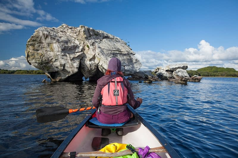 Canoeist beside Elephant Rock, Lough Leane, Killarney National Park, County Kerry, Ireland.