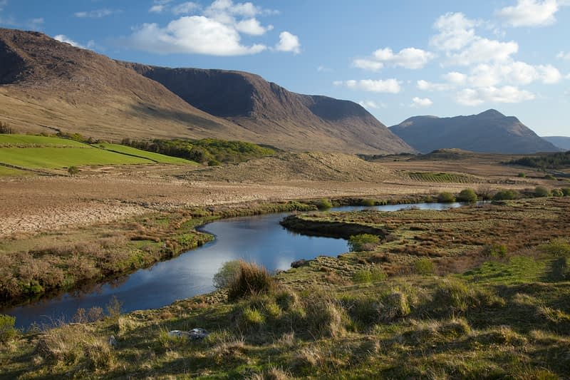 The Partry Mountains rise above the Owenmore River, Co Mayo, Ireland.