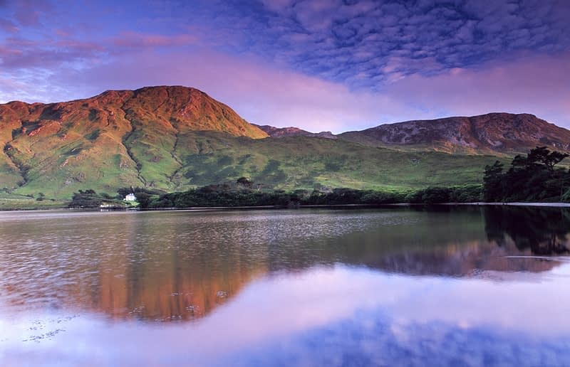Evening reflections in Kylemore Lough, Connemara, Co Galway, Ireland.