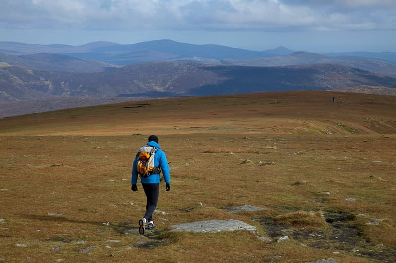 Walker descending towards Cloghernagh from Lugnaquilla, Wicklow Mountains, County Wicklow, Ireland.